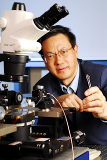 Caption: Zhong Lin Wang, Regents Professor in the School of Materials Science and Engineering at Georgia Tech, holds a prototype DC nanogenerator fabricated using an array of zinc oxide nanowires. Credit: Georgia Tech Photo: Gary Meek. Usage Restrictions: None