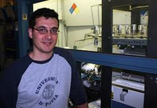 Cesare Soci, one of two primary authors on the Nano Letters paper and a postdoctoral researcher in the Deli Wang lab at the Jacobs School. Soci is standing next to equipment used to grow nanowires.