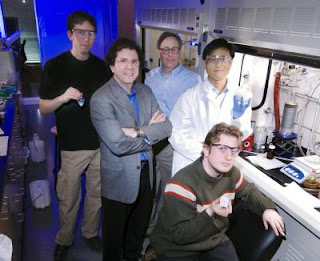 Caption: A team of researchers at the Georgia Institute of Technology has developed a new technique for creating films of nanoparticles in a polymer matrix. Shown are Peter Hotchkiss, Joe Perry, Seth Marder, Philseok Kim and Simon Jones -- who is holding a capacitor array device made with barium titanate nanocomposite. Credit: Georgia Tech Photo: Gary Meek, Usage Restrictions: None