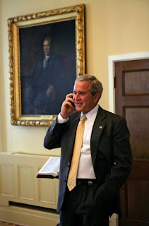 President George W. Bush congratulates San Francisco Giants' Barry Bonds in a phone call from the U.S. Department of the Treasury, Wednesday, Aug. 8. 2007. Mr. Bonds hit his record-breaking 756th home run during last night's game against the Washington Nationals in San Francisco. White House photo by Chris Greenberg