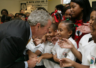 President George W. Bush greets students at the Dr. Martin Luther King Jr. Charter School for Science and Technology Wednesday, Aug. 29, 2007, in New Orleans. White House photo by Chris Greenberg