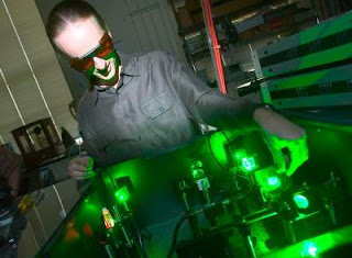 Caption: Matthew Pelton of Argonne's Center for Nanoscale Materials adjusts a green laser used to monitor the sporadic blinking of quantum dots. Credit: Jason Smith. Usage Restrictions: None.