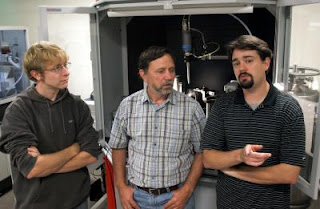 Graduate student Zachary Mensinger, left, talks with co-authors Lev N. Zakharov, center, and Darren Johnson