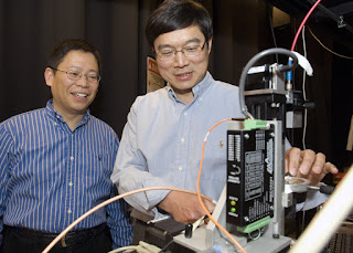 biomedical engineers Younan Xia (left) and Lihong Wang