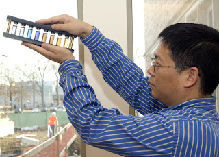 Younan Xia holds an array of glass vials