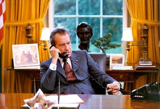 President Nixon at his desk in the Oval Office