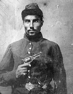 Seated black soldier with pistol and jacket