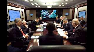 President Barack Obama holds his first meeting on Iraq in the Situation Room of the White House
