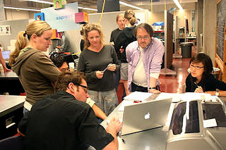 David Guston and Cynthia Selin (center) work with students