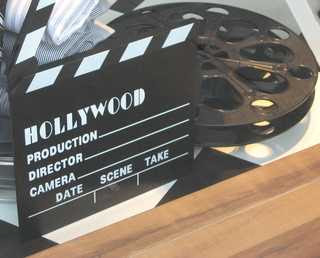 film reel and clapboard photo by sookietex