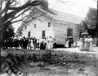 African American men, women and children outside of church