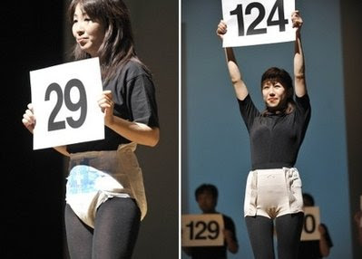 Japanese models displaying the latest styles of adult diapers during a ...