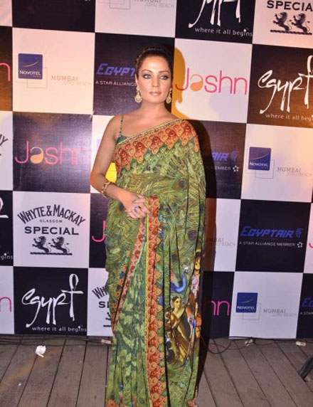 Celina Jaitley in green saari at Launching Jashns  Calendar hot photos