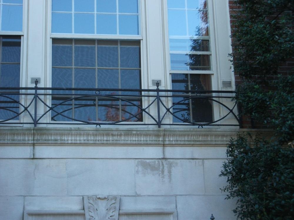 Limestone boxwoods for French balcony railing