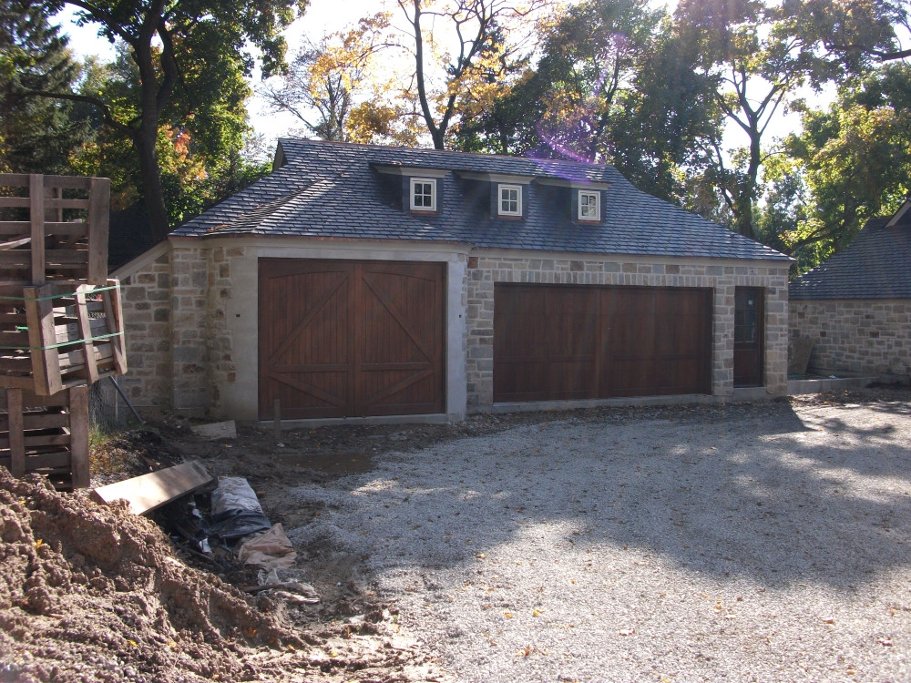 Limestone boxwoods a stone french manor in lake forest for How big is a two car garage door