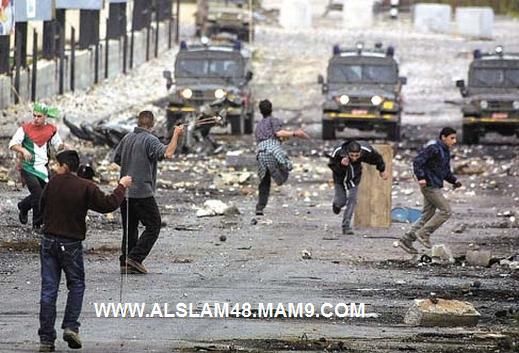 صور أطفال فلسطين أطفال الحجارة أبطال اليوم والغد((متجدد)) TAHK011009-1