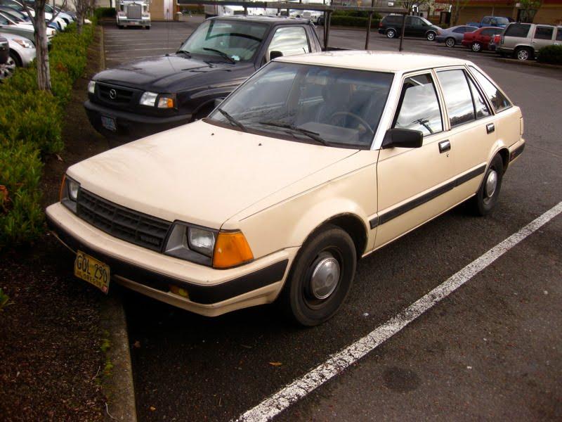 OLD PARKED CARS.: 1983 Datsun/Nissan Stanza 4-Door Hatchback.