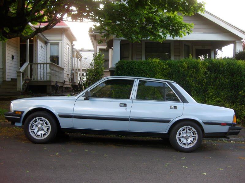 OLD PARKED CARS.: 1988 Peugeot 505 S Sedan.