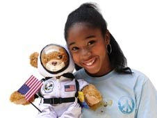 Jamia Nash cuddling a bear.