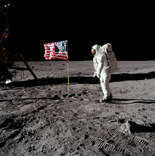 Two astronauts placed an American flag on the Moon's surface during a television broadcast of the event.