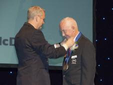 Retired NASA Apollo program astronaut James McDivitt (right) is presented with a medal by Ron Smith, vice-mayor of the City of Lancaster, Calif., at the city's Aerospace Walk of Honor induction ceremonies Sept. 19