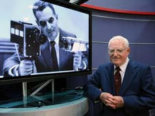 Stan Lebar next to an image of him with the lunar camera