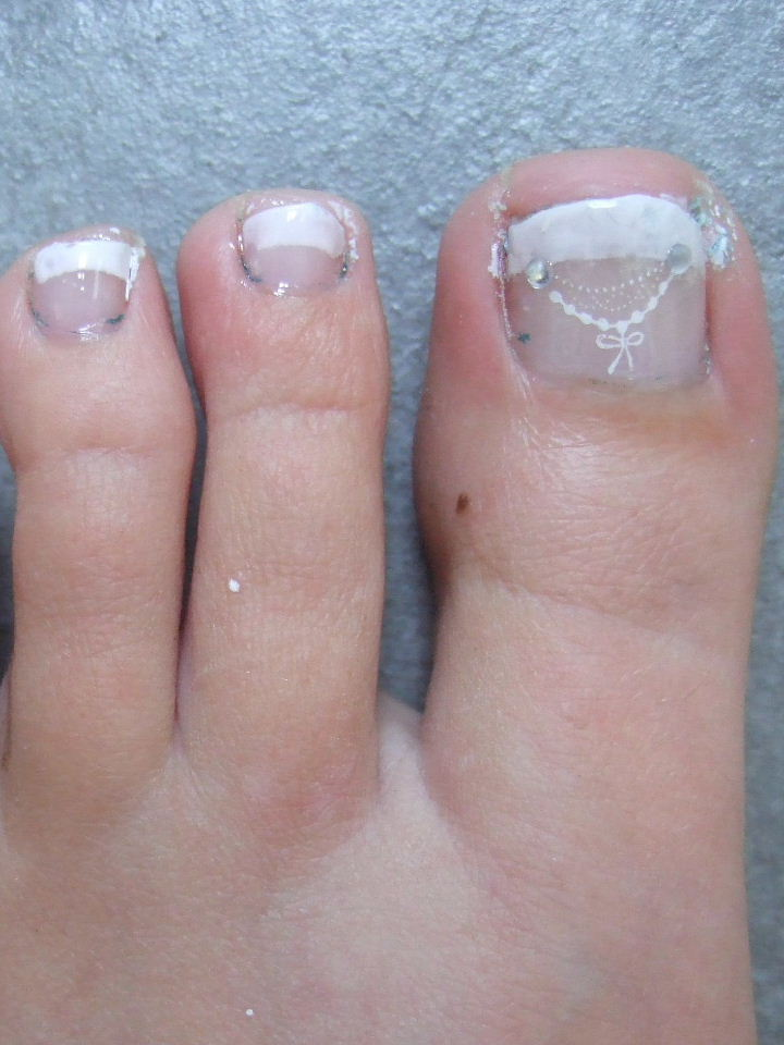 Joanne\'s nail art ideas: french pedicure with konad stamping and bling