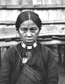 An Atayal tribal woman from southern Taiwan with tattoo on her face as a symbol of maturity, which was a tradition for both males and females.
