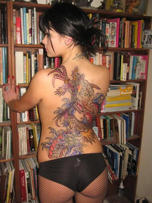 Body suits tattoo designs began on the back and continued to extend to the