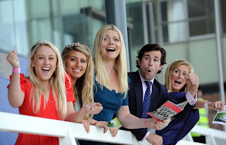 Jemma Kidd (centre) at Newbury Racecourse