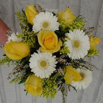 White gerbera flowers with yellow roses happy and romantic wedding bouquet