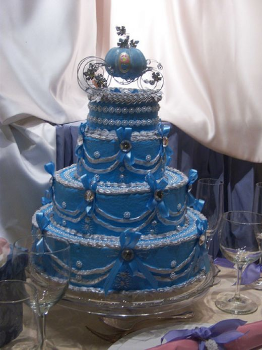 Disney wedding cake with elaborate blue and silvery pearl decorations