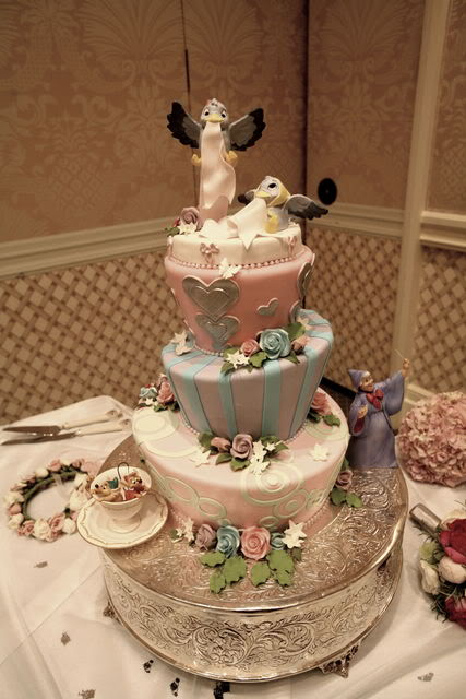 Gorgeous four tier blue Cinderella Disney wedding cake with elaborate blue