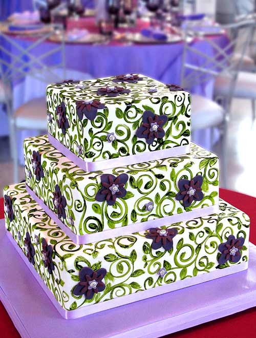 Stunning three tier purple and green wedding cake decorated with lilac