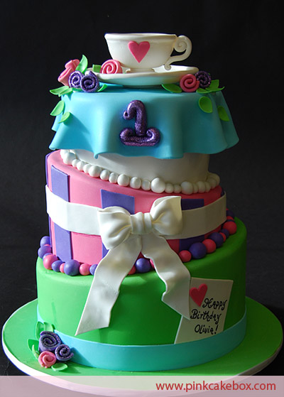 Lovely Mad Hatter Cake four tier wedding cake in blue purple green