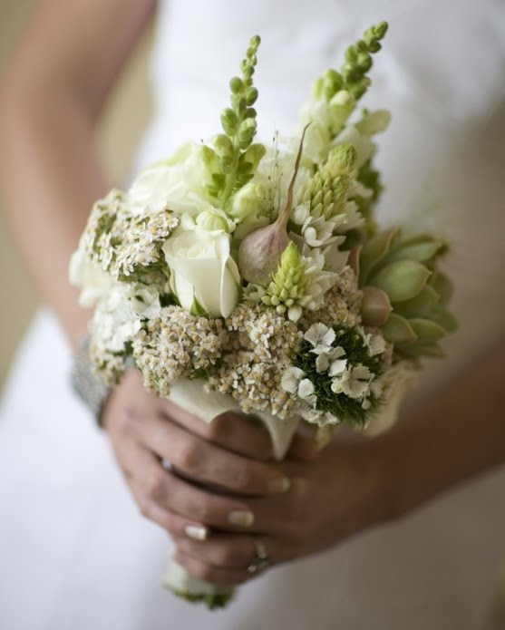 the bride 39 s bouquet has some white roses and green cactus flowers for