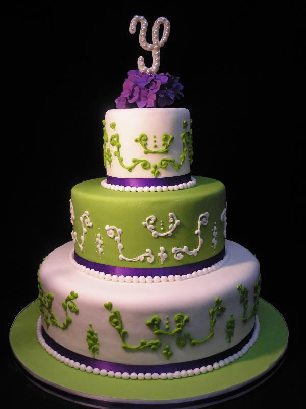 Three tier custom round white and green fondant wedding cake contemporary
