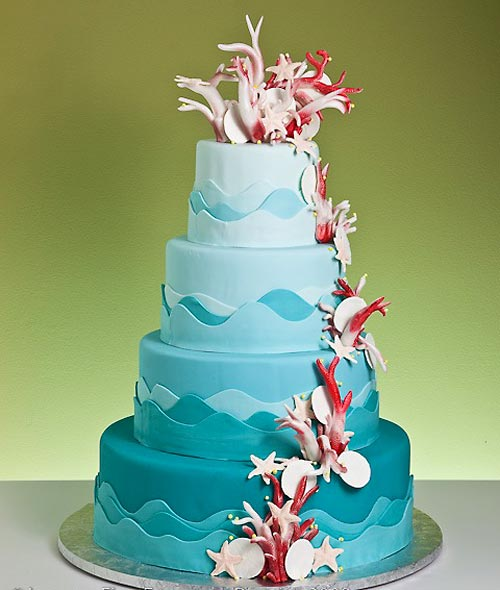 Beautiful three tiered rock candy crystals wedding cake with blue and red