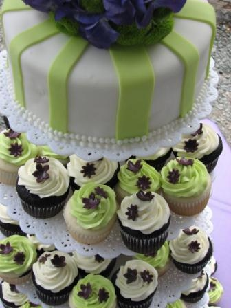 Chocolate wedding cupcakes dressed in cream icing and green topping placed
