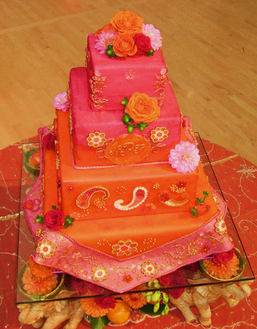 Orange And Pink Three Tier Wedding Cake Decorated With Daisies Original Design From Traceys Cakes