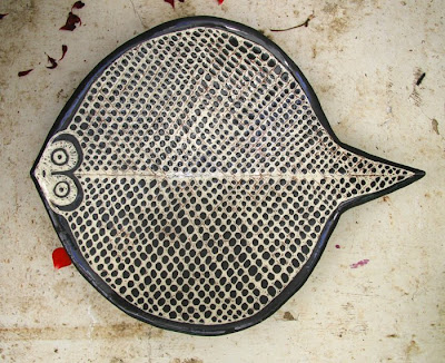 Black fish net ray
