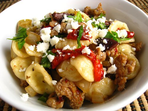 Pasta with Italian Sausage, Roasted Red Peppers, Olives and Goat Cheese