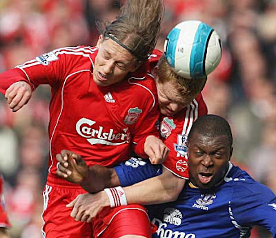 Ayegbeni Yakubu of Everton is beaten to the ball by Lucus and John Arne Riise of Liverpool.
