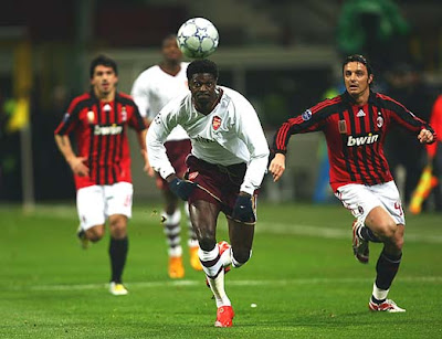 Emmanuel Adebayor of Arsenal breaks away with the ball from Massimo Oddo of AC Milan during their UEFA Champions League Round of 16 second-leg match at the San Siro stadium on March 4, 2008 in Milan, Italy.