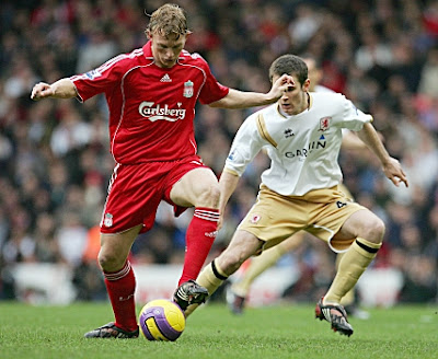 Liverpool forward Dirk Kuyt (left) shields the ball from Middlesbrough defender Jonathon Grounds. The Reds won 3-2.