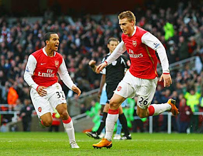 Nicklas Bendtner (right) of Arsenal celebrates with team mate Theo Walcott (left) after scoring a last minute equaliser against Aston Villa. The match ended in a 1-1 draw.