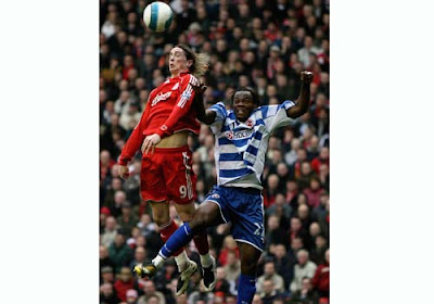 Fernando Torres of Liverpool in action with Andre Bikey of Reading