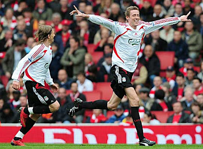 Peter Crouch of Liverpool celebrates after scoring against Arsenal near the end of the first half.