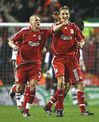 Sami Hyypia (R) of Liverpool celebrates scoring an equalizing goal with teammate Martin Skrtel.