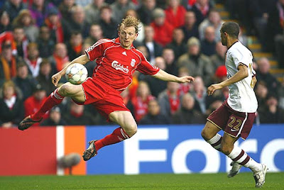 Dirk Kuyt of Liverpool shoots at goal during the UEFA Champions League quarterfinal